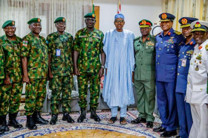 President Muhammadu Buhari, and the sacked Service Chiefs and other officers in a file photo